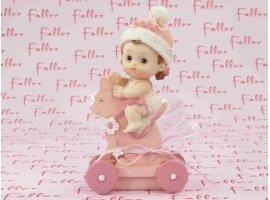Dragées Baptême - Bébé sur cheval à roulette en rose pour fille